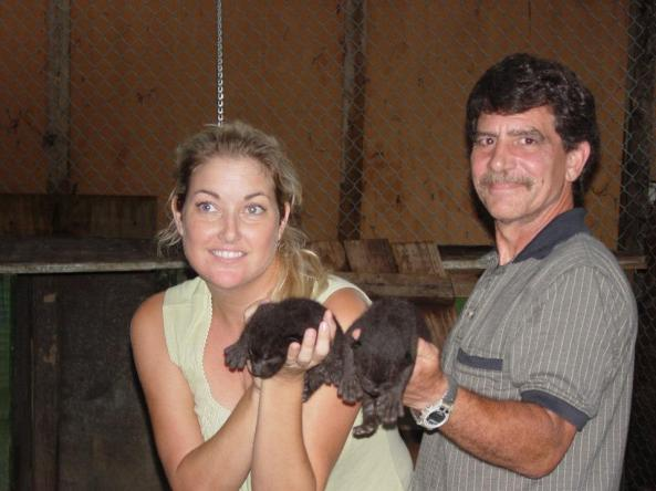 Lori Ensign-Scroggins and Kurt Beckelman hold two male African leopard cubs born Dec. 9, 2004, from the intentional breeding of two of Safari's leopards: Mirage and Oscar. This is the first of two litters born to the pair. — at Safari's Sanctuary Zoo.